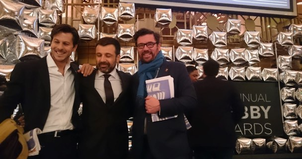Carlos with members of El Prado team celebrating the Webby Award