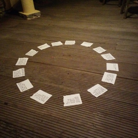 Circle of cards on the ground