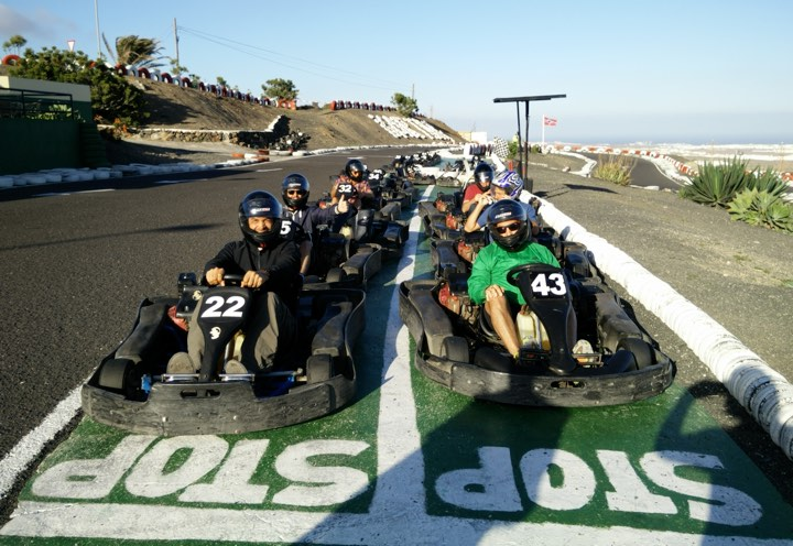 ilios team on the starting grid of a karting circuit