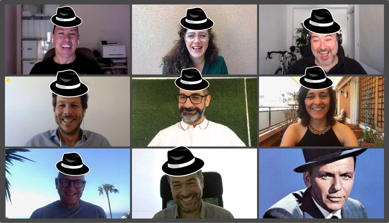 Videoconference with all members of the ilios team, all laughing.